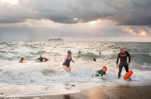 GREAT OUTDOORS: Early morning swimmers enjoying the cool October tempertures at the seaside while the passenger ferry Pont-Aven passes at sunrise in Myrtleville, Co Cork. Photograph: David Creedon/Anzenberger