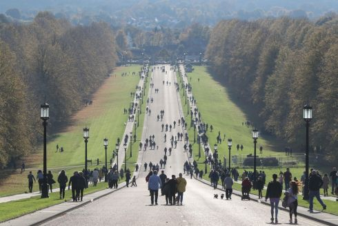 PATH TO POWER: People enjoying the autumn sunshine on the Stormont estate in Belfast. Photograph: Niall Carson/PA Wire