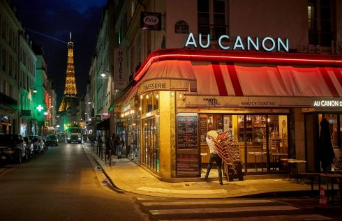 LAST TANGO IN PARIS: A bar owner closes up before the city-wide curfew came into effect in Paris at 9pm on Saturday night. Photograph: Kiran Ridley/Getty Images