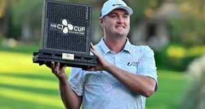 Jason Kokrak holds the championship trophy after winning the CJ Cup at Shadow Creek in Las Vegas. Photograph: AP