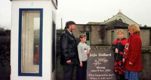 Jo Jo Dullard's sister Mary Phelan, right, in Novermber 1998 with her husband Martin and their children with the memorial stone besides the phone box that JoJo made her last call from, in Moone Co Kildare. Photograph: John Cogill