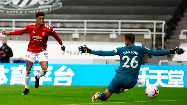 Marcus Rashford rounds off the scoring for Manchester United against Newcastle. Photograph: Alex Pantling/EPA