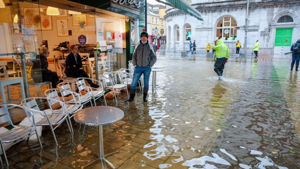O'Briens coffee shop staff pictured during heavy flooding on Winthrop street, Cork. Photograph: Daragh Mc Sweeney/Provision