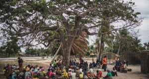 Residents at the village of Aldeia da Paz outside Macomia, Mozambique, after an attack by Islamist militants in 2019. Photograph: Marco Longari/AFP via Getty Images