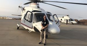 Helicopter pilot Dave McInerney gets ready to start work