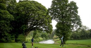 A view of members of the public playing golf at Bunclody Golf Club while adhering to social distancing on the day courses reopened in May. Photo: Dan Sheridan/Inpho