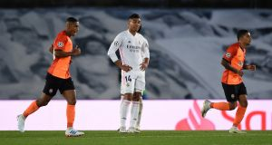 Casemiro of Real Madrid reacts as Shakhtar Donetsk players celebrate their side's second goal during the Uefa Champions League Group B match at Estadio Alfredo Di Stefano. Photo: Denis Doyle/Getty Images