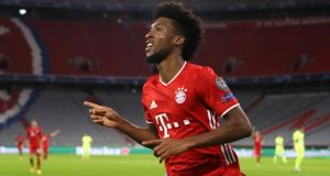 Kingsley Coman of Bayern Munich celebrates after scoring his team's fourth goal during the Uefa Champions League Group A match against Atletico Madrid at Allianz Arena. Photo: Alexander Hassenstein/Getty Images