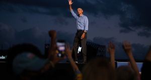 Former president Barack Obama waves to the crowd after speaking at a 'drive-in rally' in support of Joe Biden in Philadelphia. Photograph: Kriston Jae Bethel/The New York Times