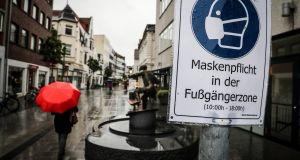 A sign reading 'Face masks mandatory inside the pedestrian zone' in Delmenhorst, northern Germany, a town which has become a recent Covid-19 hotspot. Photograph: Focke Strangmann/EPA.