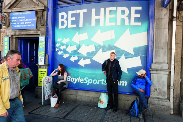 A sly image of the front of a betting shop in Dublin in 2016: all the arrows point towards migration. Photograph: Martin Parr