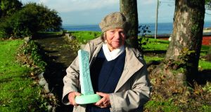 Sandycove-based artist Imogen Stuart with a small prototype of the planned standing stone sculpture for Otranto Park.