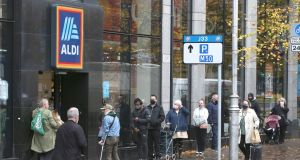 Pictures appeared on social media of queues outside Aldi – with some claiming to have been in line since 6am – for a toy sale on Thursday. Above, a queue on Tuesday at Aldi on Parnell Street, Dublin. Photograph:  Stephen Collins