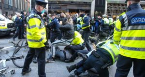 Violence flares as anti-lockdown protesters clash with gardaí on Grafton Street in Dublin. Photograph: Damien Storan