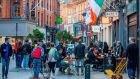 People drink at outside tables on a busy Grafton Street in Dublin on October 21st,  as Ireland prepares to enter a second national lockdown to stem the spread of the virus that causes Covid-19. Photograph: Paul Faith/AFP via Getty Images