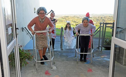DRESS UP: Sixth class students arrive in fancy dress at Crubany National School, Cavan on Friday morning.  Children all over Ireland will miss out on the annual tradition of trick or treating due to Level 5 restrictions. Photograph: Lorraine Teevan