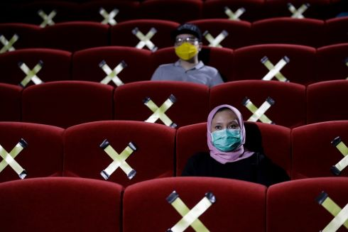 SPACED OUT: People sit near seats marked for physical distancing at Cinepolis movie theatre following the ease of coronavirus restrictions in Jakarta, Indonesia on October 23rd. Jakarta's administrations allows movie theaters to resume their operations with 25 percent capacity following the ease of Covid-19 pandemic restrictions. Photograph: Mast Irham/EPA