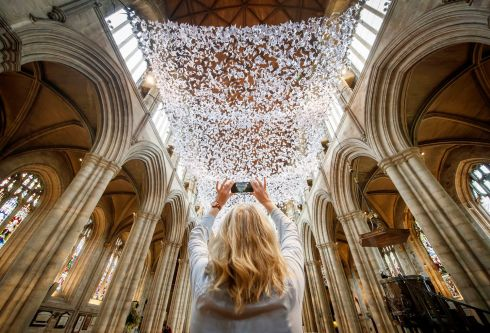 ANGELS: Michele Gee takes a photograph of 'The Wing and A Prayer', an installation of 10,000 angels at Ripon Cathedral, designed during the Covid-19 lockdown to support the community through prayer. Photograph: Danny Lawson/PA Wire