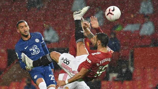 Manchester United's Portuguese midfielder Bruno Fernandes tries an overhead kick during his side's goalless draw at Old Trafford. Photograph: Oli Scarff/Getty/AFP