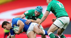 Will Connors tackles Italy's Luca Morisi on his Ireland debut. Photograph: Bryan Keane/Inpho