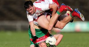 HEAD THE BALL: Mayo's Fionn McDonagh (below) and Hugh Pat McGeary of Tyrone in action during their encounter in an Allianz Football League Division 1 match at Elverys MacHale Park, Castlebar, Co Mayo. Photograph: Laszlo Geczo/Inpho