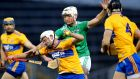 Clare's Jack Browne under pressure from Kyle Hayes of Limerick during the Munster SH quarter-final at Thurles. Photograph: Ryan Byrne/Inpho