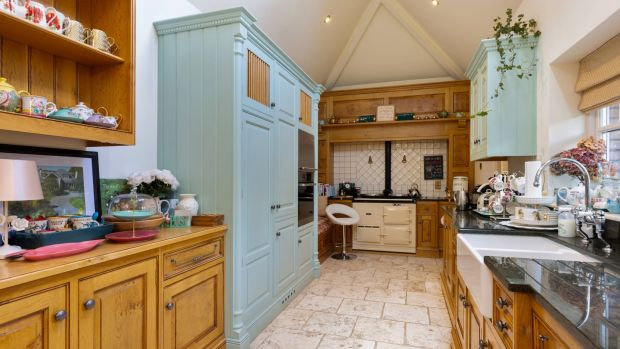 The kitchen at Mountain Lodge is fitted in rustic country style.