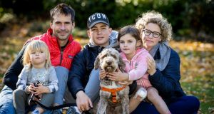 Zara Flynn and Tim Mackey with James (14), Alice (6),   Sam (2) and Chewy.  Photograph: Tom Honan