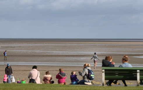 HOP TO IT: Exercising on Sandymount Strand in Dublin, with the tide out. Photograph: Nick Bradshaw