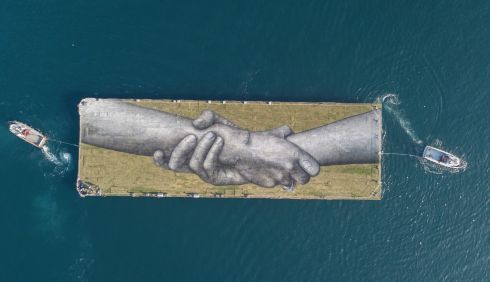 HANDS-ON PROJECT: A giant biodegradable painting by French-Swiss artist Saype, the eighth step of his worldwide Beyond Walls Project, on a floating barge at Halic Bay, near the Bosporus, in Istanbul, Turkey. The work involved pigments made of charcoal, chalk, water and milk proteins. Photograph: Tolga Bozoglu/EPA