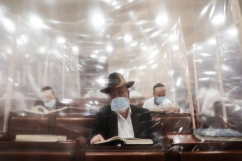 LIVING IN A BUBBLE: Ultra-Orthodox Jews wearing protective face masks study the Torah in a synagogue with plastic-separated capsule tables, aimed at preventing Covid-19 infection, in a religious neighbourhood of Jerusalem, Israel. Photograph: Abir Sultan/EPA