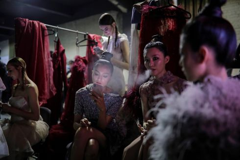 BEIJING FASHIONS: Models wait backstage ahead of their presentation of creations from the YINMU collection by designer Wei Jiang, during China Fashion Week, in Beijing, China. Photograph: Wu Hong/EPA