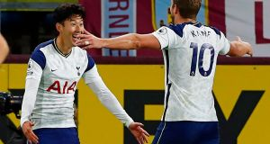 Son celebrates his winner for Spurs against Burnley with Harry Kane. Photograph: Jason Cairnduff/Getty/AFP