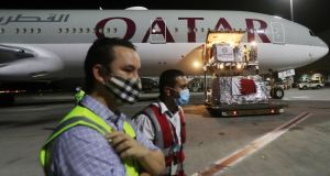Supplies being loaded on to a  Qatar Airways flight in Doha. Photograph:  Karim Jaafar/AFP via Getty Images
