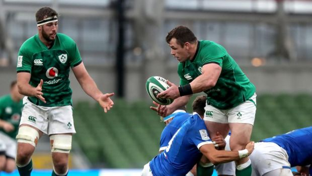 Cian Healy offloads to Caelan Doris during the Six Nations game against Italy at the Aviva Stadium. Photograph: Bryan Keane/Inpho