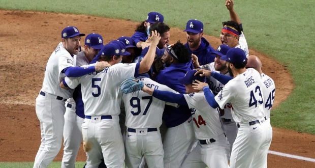 The Los Angeles Dodgers celebrate after defeating the Tampa Bay Rays 3-1 in Game Six to win the 2020 World Series. Photograph: Sean M Haffey/Getty