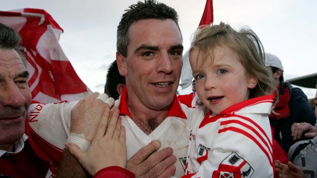 Pádraic Joyce with his daughter Ava at the 2007 Galway Club Football Final. Photograph: Lorraine O'Sullivan/Inpho