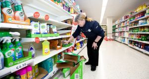 Marie Downey stocks the shelves in the Tesco superstore in Stillorgan, Co Dublin with disinfectant wipes. Photograph: Tom Honan/The Irish Times