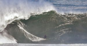Surfers take to high waves caused by Atlantic swells in Mullaghmore in Co Sligo. Photograph: Niall Carson/PA Wire