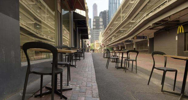 Cafe chairs and tables are set out on a lane in Melbourne on Wednesday as the city emerges from lockdown. Photograph: Carla Gottgens/Bloomberg
