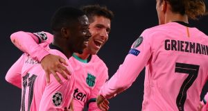 Ousmane Dembele celebrates his opening goal with Barcelona team-mates  during the Champions League Group G match against Juventus in Turin. Photograph: Marco Bertorello/AFP via Getty Images