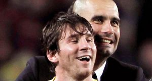 Barcelona's head coach Pep Guardiola with  Lionel Messi in 2011. Photograph: EPA
