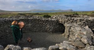 SAMHAIN: Juli Ní Mhaoileóin, The Dingle Druid, connecting with the energy of Samhain, at Cathair Deargáin, Stone Fort, at Baile na nGall, on the Dingle Peninsula.  The ancient Celtic festival of Samhain has been celebrated in Ireland for over 2000 years. Photograph: Valerie O'Sullivan