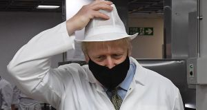 British prime minister Boris Johnson visiting a  hospital in Reading, west  London.  He is weighing up whether to scrap his three-tiered local lockdown approach. Photograph:   Jeremy Selwyn/pool/AFP via Getty Images