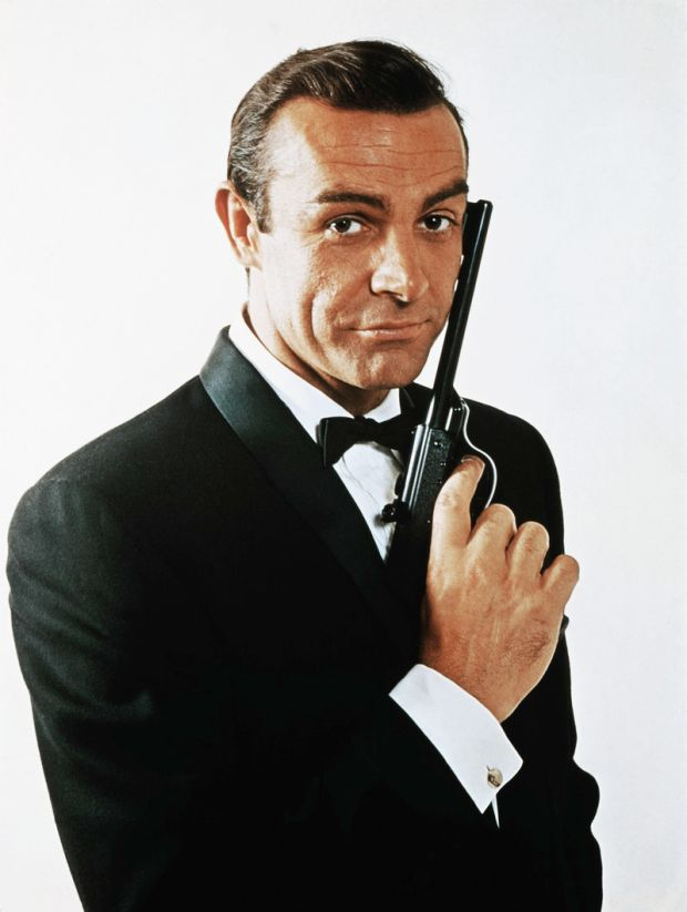 Portrait of Sean Connery, as James Bond, caressing the barrel of a gun against the side of his face. Photograph: Bettmann/CORBIS