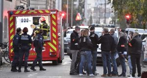 Security and emergency personnel  in Lyon at the scene where an attacker armed with a sawn-off shotgun wounded an Orthodox priest in a shooting before fleeing, said a police source. Photograph: AFP