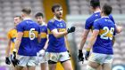 Tipperary's Colman Kennedy touches knuckles with his teammates after their win over Clare in the Munster Senior Football Championship. Photo: Bryan Keane/Inpho