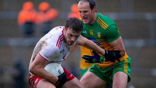Michael Murphy challenges Brian Kennedy during Donegal's win over Tyrone. Photograph: Morgan Treacy/Inpho
