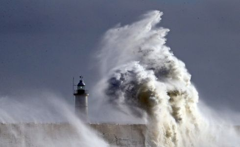 TAKING A HAMMERING: Large waves crash over the harbour wall in Newhaven, East Sussex, amid strong winds, as the remnants of ex-tropical Storm Zeta pass over England. Photograph: Gareth Fuller/PA Wire