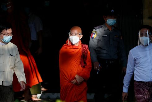 MONK SURRENDERS: Buddhist monk U Wirathu, a nationalist, arrives outside the Yangon western district police station, in Yangon, Myanmar. Wirathu, who had been on the run since May 2019, surrendered himself to police on Monday. An arrest warrant had been issued for his attempts to excite disaffection with the government, a crime carrying a maximum penalty of life imprisonment. Photograph: Lynn Bo Bo/EPA
